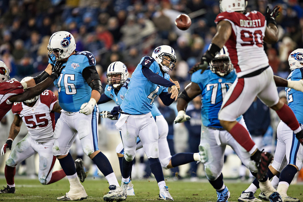 NASHVILLE, TN - DECEMBER 15: Ryan Fitzpatrick #4 of the Tennessee Titans throws a pass against the Arizona Cardinals at LP Field on December 15, 2013 in Nashville, Tennessee.  The Cardinals defeated the Titans 37-34.  (Photo by Wesley Hitt/Getty Images) *** Local Caption *** Ryan Fitzpatrick