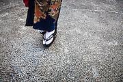 JAPAN, TOKYO, April 2013 - Emi Wakita, a young woman who define her style between scary and cute in  a Japanese garden near Gokokuji temple in tokyo. She use white rice powder as the geisha, yellow lips, long false lash,  and five differents colored wigs [FR] Emi wakita, une jeune femme en kimono dans un jardin Japonais proche du temple bouddhiste Gokokuji. Elle définit son style entre le Kawaii mignon et le kowai effrayant . Elle se farde de blanc avec la poudre de riz comme le font les geisha, ses levres sont Jaunes, elle porte cinq perruques colorées et des plumes rouges