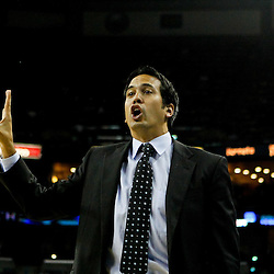 October 13, 2010; New Orleans, LA, USA; Miami Heat head coach Erik Spoelstra reacts to an officials call during the second half of a preseason game against the New Orleans Hornets at the New Orleans Arena. The Hornets defeated the Heat 90-76. Mandatory Credit: Derick E. Hingle
