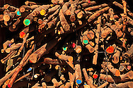 A wood pile with colorful paint marks on some of the logs. WATERMARKS WILL NOT APPEAR ON PRINTS OR LICENSED IMAGES.
