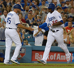 June 21, 2017 - Los Angeles, California, U.S. - Los Angeles Dodgers' Yasiel Puig high fives third base coach Chris Woodward (45) after hitting a three run home run against the New York Mets in the fourth inning of a Major League baseball game at Dodger Stadium on Wednesday, June 21, 2017 in Los Angeles. Los Angeles. (Photo by Keith Birmingham, Pasadena Star-News/SCNG) (Credit Image: © San Gabriel Valley Tribune via ZUMA Wire)