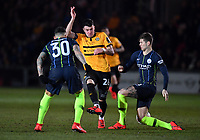 Football - 2018 / 2019 Emirates FA Cup - Fifth Round: Newport County vs. Manchester City<br /> <br /> Newcastle United's Karl Darlow battles for possession with Manchester City's Nicolas Otamendi and John Stones, at Rodney Parade.<br /> <br /> COLORSPORT/ASHLEY WESTERN