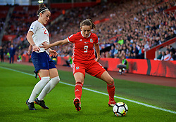 SOUTHAMPTON, ENGLAND - Friday, April 6, 2018: Wales' Kayleigh Green and England's Lucia Bronze during the FIFA Women's World Cup 2019 Qualifying Round Group 1 match between England and Wales at St. Mary's Stadium. (Pic by David Rawcliffe/Propaganda)