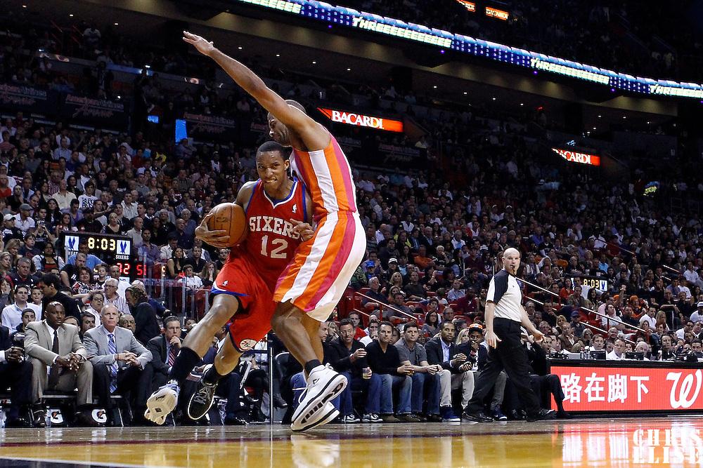 21 January 2012:  Philadelphia Sixers shooting guard Evan Turner (12) drives past Miami Heat small forward Shane Battier (31) during the Miami Heat 113-92 victory over the Philadelphia Sixers at the AmericanAirlines Arena, Miami, Florida, USA.