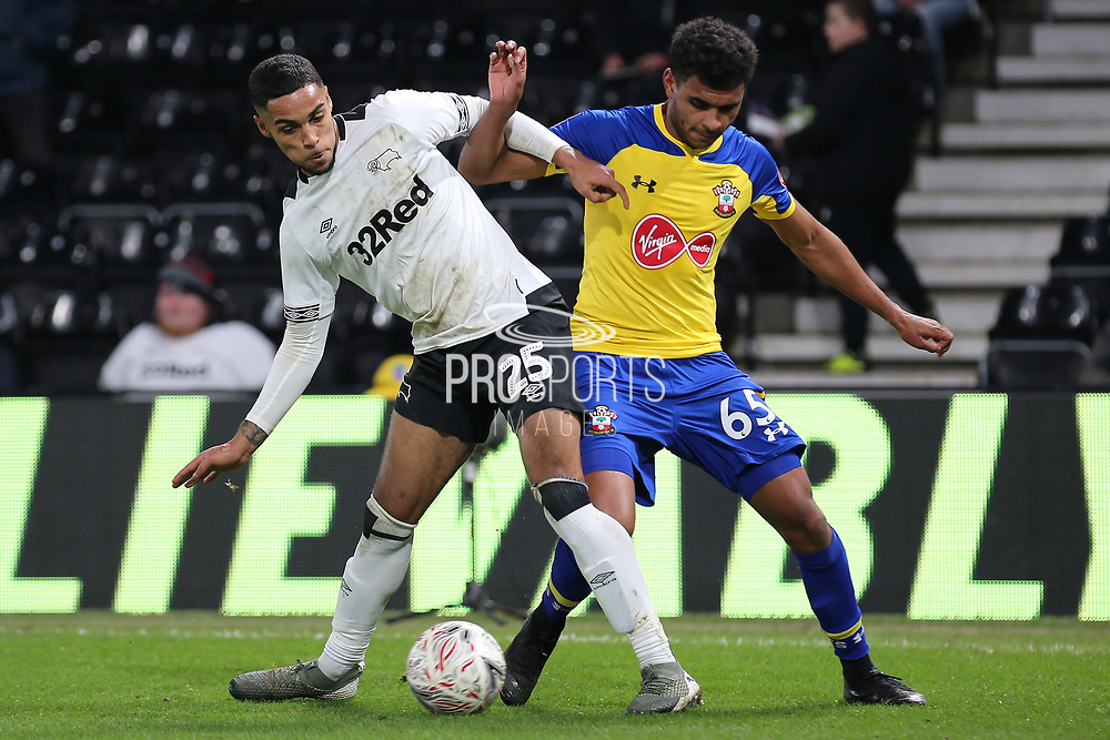 Derby County defender Max Lowe and Southampton forward Marcus Barnes challenge for the ball during the The FA Cup 3rd round match between Derby County and Southampton at the Pride Park, Derby, England on 5 January 2019.