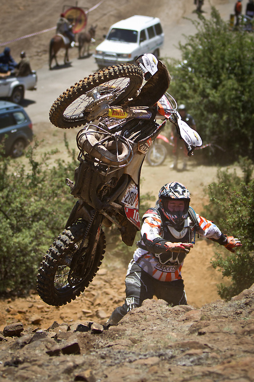 Mike Varrie tries to launch his bike up a ledge during the 44th running of the Roof of Africa enduro held in Lesotho.