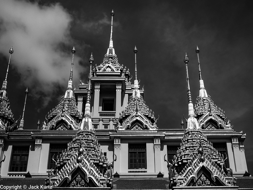 10 APRIL 2017 - BANGKOK, THAILAND: The spires of Loha Prasat at Wat Ratchanatdaram, which means iron castle or iron monastery. The 37 virtues that are required to reach enlightenment are signified by 37 black metal spires. The 36 m high multi-tiered structure consists 3 levels, the bottom one has 24 spires, the middle one 12 and the top level has 1 spire. Wat Ratchanatdaram is a Buddhist temple in Phra Nakhon district, Bangkok. It means Temple of the Royal Niece, the temple was built on the orders of King Nangklao (Rama III) for the princess granddaughter, Somanass Waddhanawathy in 1846.      PHOTO BY JACK KURTZ
