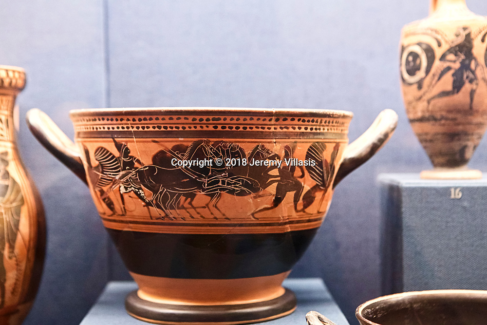 Attic black-figure skyphos (drinking vessel) with depiction of quadriga and Amazons. (500-490 BC)