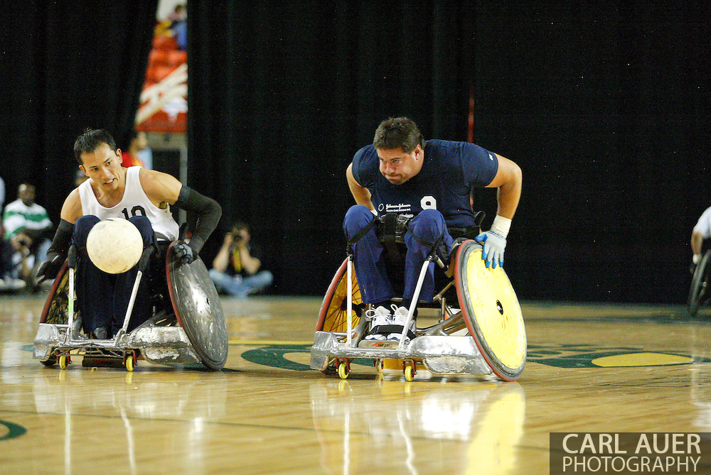 July 7th, 2006: Anchorage, AK - Scot Severn (9) and William Groulx (10) chase after the ball as White defeated Blue in the gold medal game of Quad Rugby at the 26th National Veterans Wheelchair Games.
