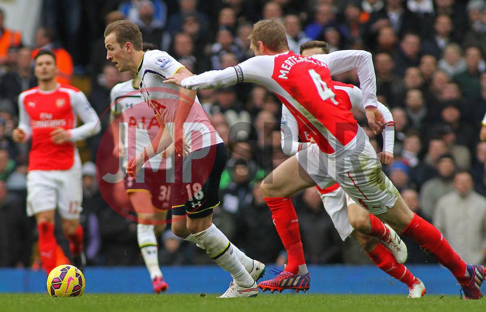 Tottenham Hotspur's Harry Kane and Arsenal's Per Mertesacker compete for the ball - Photo mandatory by-line: Mitchell Gunn/JMP - Mobile: 07966 386802 - 07/02/2015 - SPORT - Football - London - White Hart Lane - Tottenham Hotspur v Arsenal - Barclays Premier League