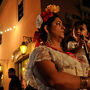 "Adriana Delfin holds her grandaughter Rosaria while watching performances at the VIII Encuentro de Jaraneros de California, in Lynwood, Calif.,  on Saturday, June 27, 2009, at the Plaza Mexico.  The ""Encuentro"", as it is commonly referred to by attendees, is an annual music event featuring music and dance performances that celebrate Son Jarocho music and culture from the Mexican state of Veracruz. Photo by Jen Klewitz"