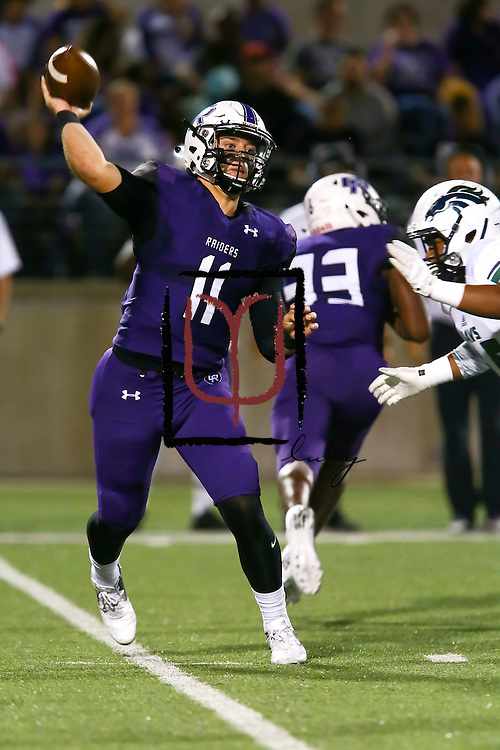 Cedar Ridge quarterback Garrett Sharpe attempts a pass against McNeil Mavericks Friday.  The Raiders beat the Mavs 52-7 at Kelly Reeves Athletic Complex.  (LOURDES M SHOAF for Statesman.)