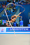 Staniouta Melitina during final at ribbon in Pesaro World Cup April 12, 2015. Melitina is an Belarusian rhythmic gymnast, she was born in November 15, 1993 in Minsk. She is a three time World All-around bronze medalist in 2015, 2013, 2010 retired from rhythmic gymnastics in December 2016.