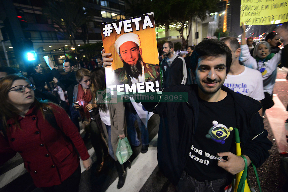 May 3, 2017 - Sao Paulo, Brazil - The Right São Paulo group organized a march against the Immigration Law in the city of Sao Paulo on 3 May 2017. The demonstration took place on Paulista Avenue and at its peak gathered about two hundred people. They ask President Michel Temer to veto the law. The protest protested against the Migration Law, already approved by the Senate, which could facilitate the reception of more immigrants in the country. Protesters say that immigrants ''brought terrorism to Brazil'' and called for a new military intervention in the country. (Credit Image: © Cris Faga/NurPhoto via ZUMA Press)