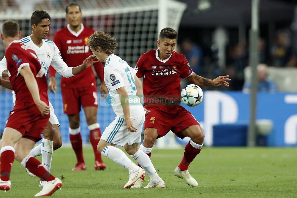 (L-R) Raphael Varane of Real Madrid, Luka Modric of Real Madrid, Roberto Firmino of Liverpool FC during the UEFA Champions League final between Real Madrid and Liverpool on May 26, 2018 at NSC Olimpiyskiy Stadium in Kyiv, Ukraine