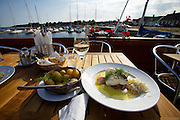 Skillinge harbour. The Hamnkrog (short: Krog) restaurant. Steamed cod loin with clarified butter and horseradish.