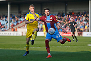 Scunthorpe United midfielder Adam Hammill (47) clears the ball during the EFL Sky Bet League 1 match between Scunthorpe United and AFC Wimbledon at Glanford Park, Scunthorpe, England on 30 March 2019.