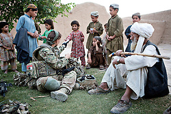 © Licensed to London News Pictures. 15/06/2012. Helmand. Anna's language training has helped her to gain access to compounds and the residents are intrigued by her. On many occasions she often pretends to have what she refers to as a 'Helmand husband' to help her gain rapport with the.women who do not understand the concept of remaining unmarried. Army women 'engagement officers' working in Afghanistan. Trained in Pashto, the Afghan language, they accompany infantry on patrols and build relationships with Afghan women in some of the most dangerous parts of Helmand. Photo credit : Alison Baskerville/LNP