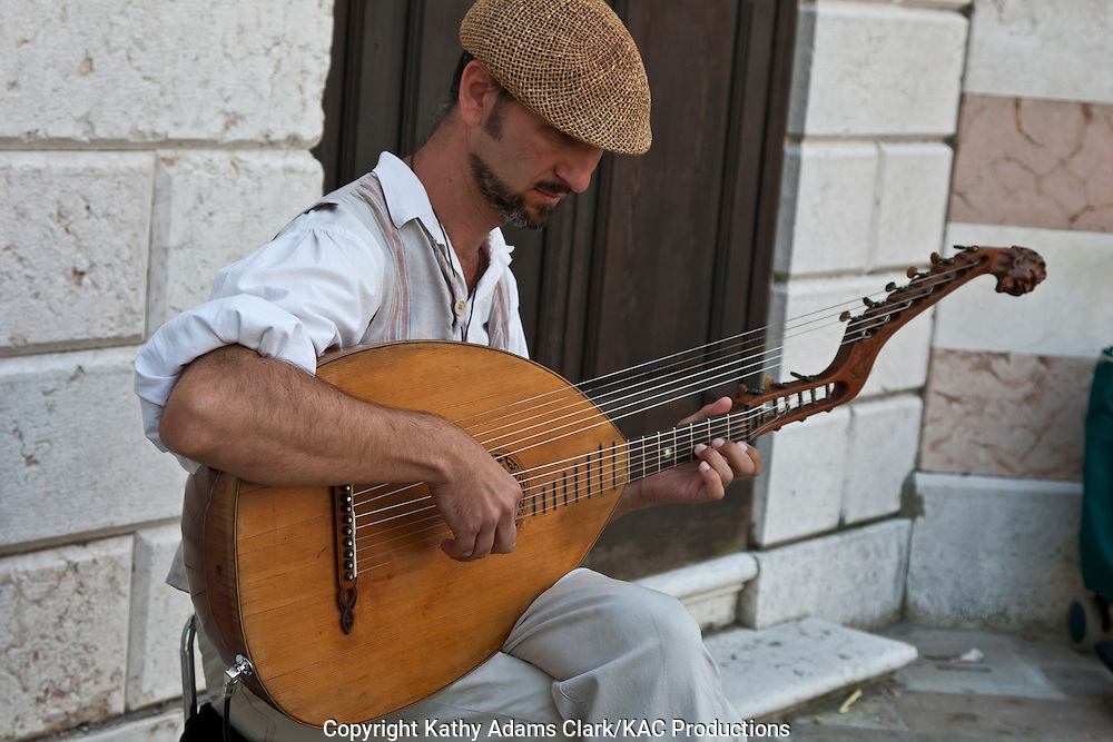 Lute player, street muscian, Venice, Italy,