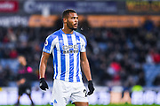 Steve Mounie of Huddersfield Town (24) in action during the Premier League match between Huddersfield Town and Everton at the John Smiths Stadium, Huddersfield, England on 29 January 2019.