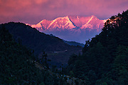 Snow clad Himalayan Ranges as seen from a hill in Mussoorie at Dusk.