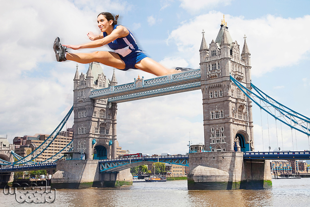Female Athlete hurdling Tower Bridge