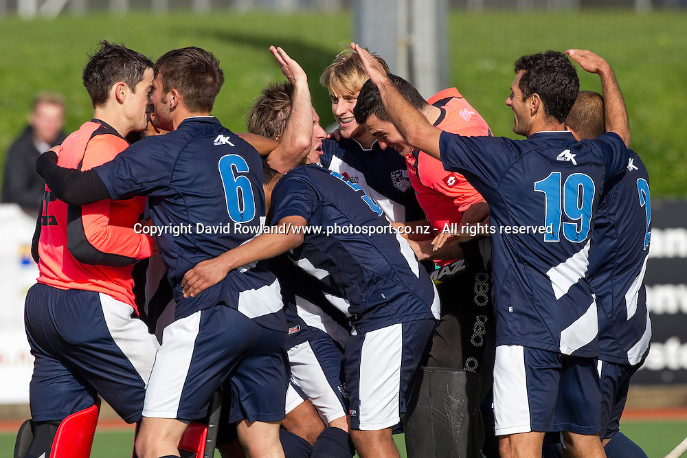 Auckland celebrate winning the Auckland v Midlands Men`s Final match, Ford National Hockey League, North Harbour Hockey Stadium, Auckland, New Zealand,Sunday, September 14, 2014. Photo: David Rowland/Photosport