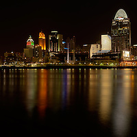 Panoramic image of Cincinnati night skyline with lights reflected on the Ohio River.