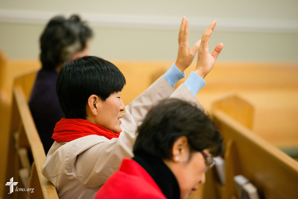 A parishioner raises her hands during Divine Service on Sunday, Nov. 23, 2014, at Living Faith Korean Lutheran Church in Cumming, Ga. LCMS Communications/Erik M. Lunsford