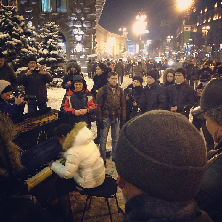 This funny EU piano has been spotted everywhere - here it's in front of City Hall - but this woman can play for real, Dec. 11, 2013. #euromaidan #kiev #ukraine #євромайдан #київ #україна #primecollective
