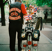 Man with his schwinn, wearing a 'Puerto Rico Schwinn club' leather waistcoat USA