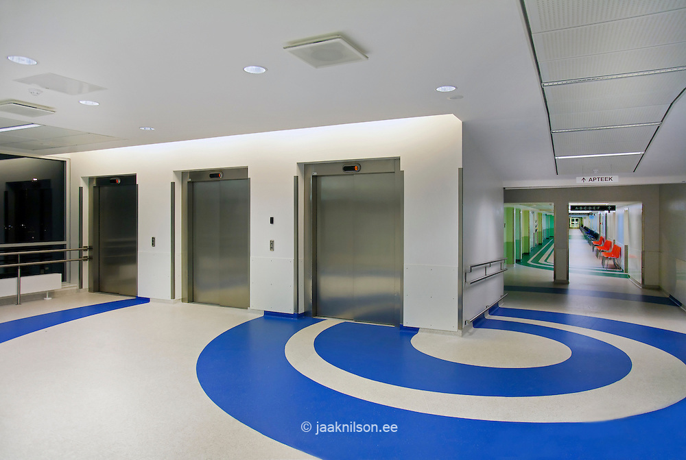 Tartu University Hospital hall in Estonia. Blue and white floor covering. Patterns and lifts