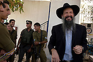 A Rabbi from the Hasidic Chabad movement performs magic tricks for Israeli soldiers who protect the Jewish community in Hebron. Some six hundred Jews live in the heart of Hebron's old city surrounded by over 160,000 Palestinian inhabitants..Hebron, Israel. 02/11/2007.Photo © J.B. Russell/Blue Press