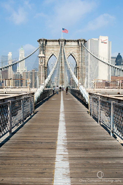 The pedestrian walkway on the  Brooklyn Bridge between Manhattan and Brooklyn over the East River. New York
