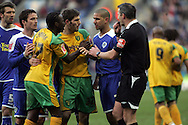 Leicester - Saturday, February 16th, 2008: Patrick Kisnorbo (R) of Leicester City argues with Mo Camara (L) and Ched Evens (C) of Norwich City after Darel Russell's tackle on Richard Stearman during the Coca Cola Champrionship match at the Walkers Stadium, Leicester. (Pic by Mark Chapman/Focus Images)