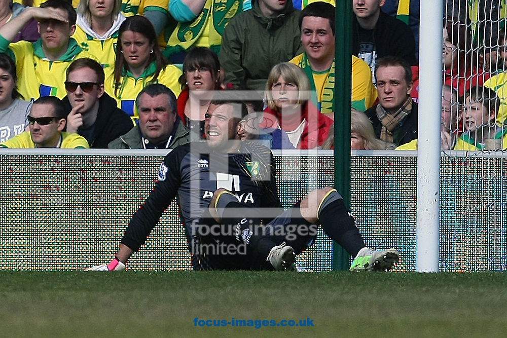 Picture by Paul Chesterton/Focus Images Ltd +44 7904 640267.06/04/2013.Mark Bunn of Norwich is injured and has to be replaced by Lee Camp of Norwich during the Barclays Premier League match at Carrow Road, Norwich.
