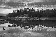 Clouds reflected in Middle Lake<br />Kenora District<br />Ontario<br />Canada