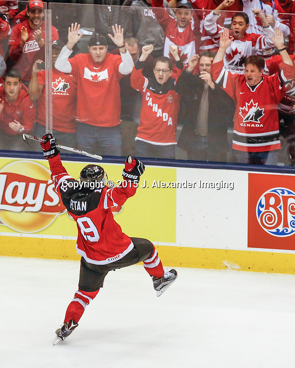 Team Canada's Nick Petan (19) celebrates his hat trick with Canadian fans during the 2015 IIHF Junior World Championships.