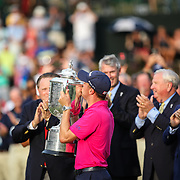 CHARLOTTE, NC - AUGUST, 14 2017:  Justin Thomas kisses the Wanamaker Trophy after being presented it for winning the 2017 PGA Championship at Quail Hollow Club.