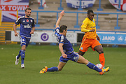 Halifax Town defender James Bolton tackles Wycombe Wanderers defender Aaron Pierre  during the The FA Cup match between FC Halifax Town and Wycombe Wanderers at the Shay, Halifax, United Kingdom on 8 November 2015. Photo by Simon Davies.