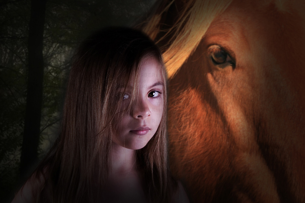 Young female child with chestnut coloured horse.
