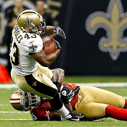 August 12, 2011; New Orleans, LA, USA; New Orleans Saints running back Darren Sproles (43) is tackled by San Francisco 49ers linebacker Parys Haralson (98) during the first half of a preseason game at the Louisiana Superdome. Mandatory Credit: Derick E. Hingle