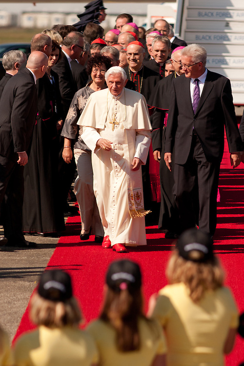 Lahr, Germany. September 24, 2011. Pope Benedikt XVI and the Minister-President of Baden-Württemberg Winfried Kretschmann (right) at the Pope's arrival at the airport in Lahr for his visit in Freiburg on Saturday. Photo: Miroslav Dakov