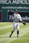 ANAHEIM, CA - JULY 20:  Brad Miller #5 of the Seattle Mariners plays catch before the game against the Los Angeles Angels of Anaheim at Angel Stadium on Sunday, July 20, 2014 in Anaheim, California. The Angels won the game 6-5. (Photo by Paul Spinelli/MLB Photos via Getty Images) *** Local Caption *** Brad Miller
