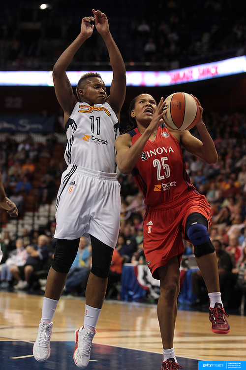 Monique Currie, Washington Mystics, (right), drives past Natasha Lacy, Connecticut Sun, during the Connecticut Sun V Washington Mystics WNBA regular season game at Mohegan Sun Arena, Uncasville, Connecticut, USA. 7th June 2013. Photo Tim Clayton