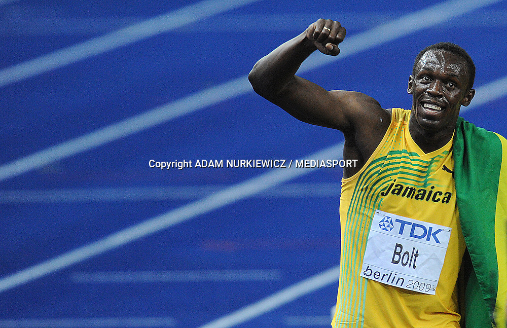 USAIN BOLT (JAMAICA) CELEBRATES AFTER WINNING 100 METERS FINAL ON THE OLYMPIC STADION ( OLIMPIASTADION ) DURING 12TH IAAF WORLD CHAMPIONSHIPS IN ATHLETICS BERLIN 2009.JAMAICAN USAIN BOLT SET A NEW WORLD RECORD OF 9.58 SECONDS...BERLIN , GERMANY , AUGUST 16, 2009..( PHOTO BY ADAM NURKIEWICZ / MEDIASPORT )..PICTURE ALSO AVAIBLE IN RAW OR TIFF FORMAT ON SPECIAL REQUEST.