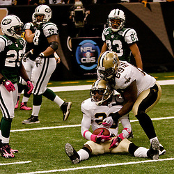 2009 October 04: New Orleans Saints cornerback Randall Gay (20) celebrates with teammate Anthony Hargrove (69) after an interception in the fourth quarter of a 24-10 win by the New Orleans Saints over the New York Jets at the Louisiana Superdome in New Orleans, Louisiana.