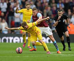 Aston Villa's Tom Cleverley battles for the ball with Liverpool's Joe Allen - Photo mandatory by-line: Alex James/JMP - Mobile: 07966 386802 - 19/04/2015 - SPORT - Football - London - Wembley Stadium - Aston Villa v Liverpool - FA Cup Semi-Final