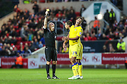Leed's Tom Adeyemi receives a yellow card during the Sky Bet Championship match between Bristol City and Leeds United at Ashton Gate, Bristol, England on 19 August 2015. Photo by Shane Healey.