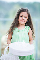 Portrait of cute girl holding gift box and basket at home